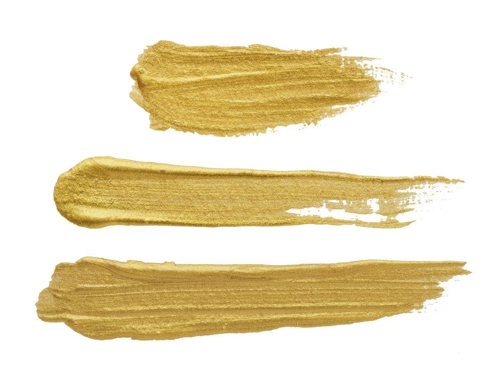 Golden brush stroke on white